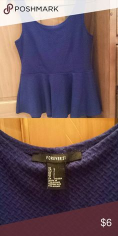 Forever 21 Blue Peplum This top is a large, but runs small, so is probably more of a medium. Cute royal blue color. A classic, chic piece that has endless possibilities! Forever 21 Tops Tank Tops
