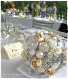 """White button bouquet & satin ribbon roses.  Use Gramma's button box collection for """"something old"""" on wedding day."""