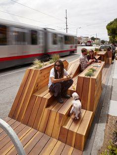 """""""Sunset Parklet"""" is inspired by San Francisco's hilly typography. The structure's miniature up and down-hills create a dynamic public space, complete with bike parking, seating, tables, and planters. #LQC #Placemaking #StreetsAsPlaces #Parklet"""