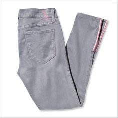 LEVEL 99 ULTRA SKINNY DENIM Swap out neutral blue or black jeans for this soft-gray pair ($135; level99jeans.com) with an unexpected pink accent on the ankle zippers. Fifty percent of sales go to the BCRF.