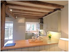 A country cottage with a stylish and sympathetic extension for Cottage kitchen extensions