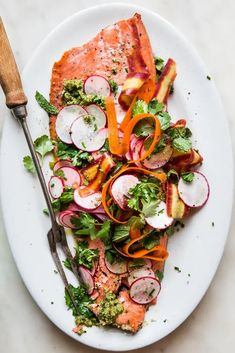 An herbal, vibrant pea-and-carrot top pesto makes the ideal partner for a big, beautiful filet of roasted salmon. Simple, colorful, healthy and so delicious, this is one dreamy dinner. Vegetable Recipes, Vegetarian Recipes, Delicious Recipes, Easy Recipes, Whole Food Recipes, Dinner Recipes, Dinner Ideas, A Food, Good Food