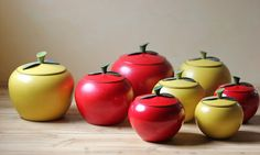 Collection of vintage apple canisters.