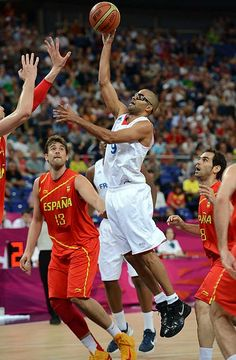 Tony Parker goes up for a shot as France took on Spain in Olympic basketball action Wednesday. Spain ultimately defeated France, advancing to a semifinals match against Russia.  #london2012