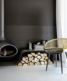 This is such a futuristic looking room! #BlackInteriors #FirePlace #HomeIdeas