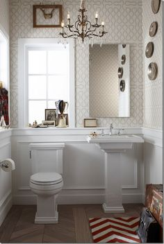 apartment therapy powder room with stenciled walls
