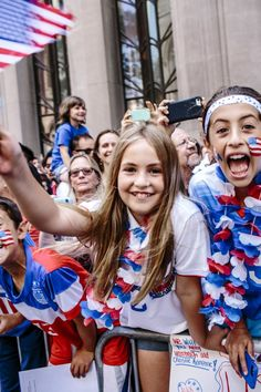 July 10 2015. New York City. Thousands of fans congregated in lower Manhattan on Friday for a Ticker Tape Parade in honor of the US Women's Soccer Team's Fifa win. Young girls and boys came out en masse to cheer on the team, painting their faces with US colors and chanting USA! as the team members passed. Mayor Bill De Blasio was also in attendance.   (Natalie Keyssar)