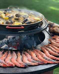 reat paella on OFYR by @de_buitenchef #bbq #barbecue #grill #plancha #hotplate #firepit #fire #outdoorcooking #paella #fish #seafood