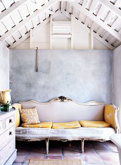 Antique French sofa + textural wall and flooring