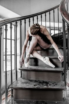 This ballerina strikes a unique pose sitting on the stairs.