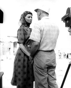 Sophia Loren pays attention to director Jean Negulesco on the Greek location of Boy on a Dolphin  1957