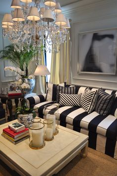 I love the the chandelier and striped couch Classy Living Room, Desk In Living Room, Home And Living, Living Room Decor, Living Rooms, Condo Living, Family Rooms, Striped Couch, Striped Furniture
