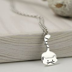 This adorable kitty cat is looking rather crafty! Ready to pounce or ready to play, this little kitty is already ready for affection. Handmade from sterling silver and bought to life in my Nottingham workshop. A great gift for any cat lover to treasure furever! - Cat measures 1.1cm