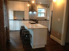Kitchen renon complete! Danby marble & honed black counters with white wood shaker cabinets.