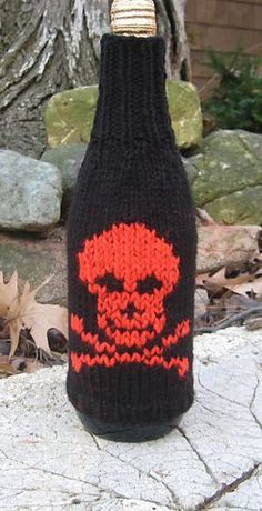 Free knitting pattern for Skull Bottle Cozy - What's your poison? Diana Troldahl designed this skull and crossbones bottle cozy and several others including xXx, Rat Bile, Rot Gut, and more.