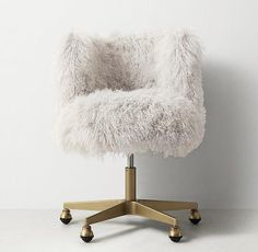 Seating - Luxurious white Mongolian fur upholstery makes it fun to get things done, surrounding you with plush comfort while you tackle the task at hand. A sturdy antique brass iron base and rolling casters help ensure it gets finished.