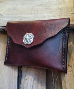Leather Coin Purse/Credit Card/Ear Bud Holder/Rosary Bead Case-Celtic Knot Snap-Mahogany & Red-Rustic/Irish/Celtic Accessories-Money Holder by LeatherVision on Etsy https://www.etsy.com/listing/249640721/leather-coin-pursecredit-cardear-bud
