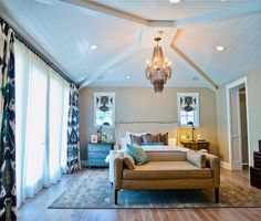 The vaulted ceiling in this neutral bedroom is heightened by a tiered chandelier. Custom ikat curtains add texture to this comfortable oasis. Master Bedroom Addition, Modern Master Bedroom, Modern Bedroom Design, Home Bedroom, Home Interior Design, Bedroom Decor, Bedroom Ideas, Master Bedrooms, Master Room
