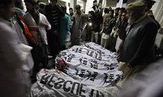 People gather around the bodies of the victims of the Bacha Khan University attack.