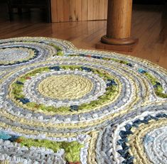 Handmade rug... this is pretty impressive! Three crochet large circles using old sheets?  Then using basic joining like a blanket and some creativity to get the shape u want!   LOVE!!!!