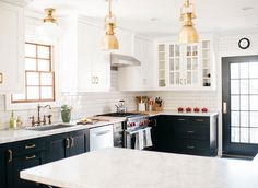 Black lower cabinets with white upper cabinets.