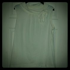 Authentic Lilly Pulitzer-never worn sleeveless top Authentic Lilly Pulitzer - NEVER BEEN WORN- cream colored sleeveless top with beautiful accent bow at neck line.  Great for layering or wearing on it's own. Lilly Pulitzer Tops