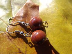 $16 - www.etsy.com/shop/JustHeathersJewelry - Brown bead earrings - ceramic - gift idea - handmade earrings. Use coupon code PINS15 for 15% off your total purchase.