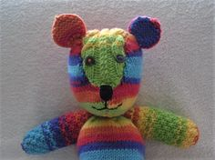 Hand knitted rainbow teddy bear by Rosiepusscrafts on Etsy