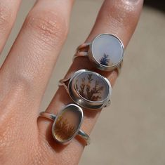The beautiful dendritic agate rings I have available in my shop. They very in sizes. These are some of my favorite stones to work with because they look like miniature paintings.