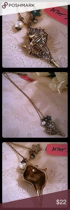 """Betsey Johnson Seashell & Charms Necklace Pretty, long gold tone bead necklace with gold tone seashell with clear rhinestones. Also has a white, faux pearl, teal enamel starfish, and clear rhinestone charms.  Necklace measures approximately 30.5"""" from end to end. Betsey Johnson Jewelry Necklaces"""