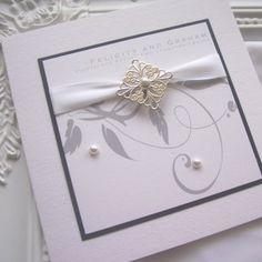 Fifi handmade wedding invitation using satin ribbon, silver filigree and pearl detailing
