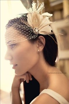 """fascinator and birdcage veil set"" Very much like what I will be using."