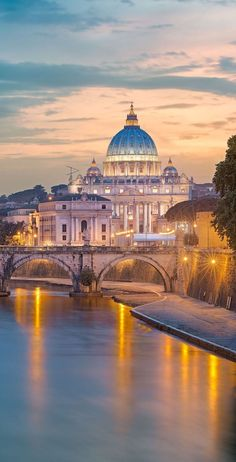 Visit the Vatican. St Peter's Basilica in the twilight, Rome, with light reflections on the Tiber River Italy Vacation, Italy Travel, Italy Trip, Rome Travel, Places To Travel, Places To Go, Voyage Rome, St Peters Basilica, Cities In Italy