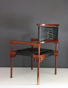 Don Shoemaker; Wood and Leather 'Perno' Chair, 1960s.