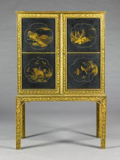 A George II style giltwood cabinet mounted with 17th century Japanese lacquer panels the gilt-heightened black lacquer with reserves of landscapes, kylins and birds, the sides glazed, within frames carved with rocaille scrolls and paterae, the interior fitted with a secretaire, the stand with square legs similarly carved and gadrooned 157cm. high, 102cm. wide, 48cm. deep; 5ft. 2in., 3ft. 4in., 1ft. 7in.