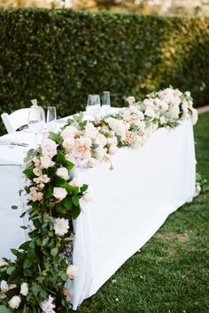 Garden wedding table decorations table flower decorations outdoor wedding table decoration with floral garland fresh floral Outdoor Wedding Tables, Wedding Table Centerpieces, Flower Centerpieces, Flower Arrangements, Table Arrangements, Centerpiece Ideas, Head Table Wedding Decorations, Wedding Table Garland, Floral Arrangement