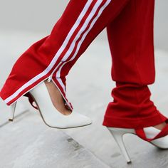competitive price abbbb 0e7e4 Streetstyle shot of Adidas tracksuit bottoms worn with heels