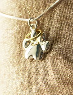 Such a beautiful, simple necklace design. Wear yours to remember a beloved pet who has crossed the rainbow bridge <3 Plus every purchase helps animals in need!