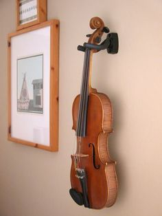 http://Amazon.com: Guitar Hanger Hook Holder Wall Mount {Would love to get two of these!  One for Talia's guitar & one for Ken's violin! .. if he wants one}