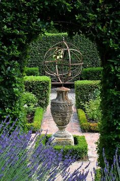 urn as base for armillary sphere -- Designer Dominique La fourcade, one of Provence's best-known Country Garden Designers -- Clive Nichols garden photography