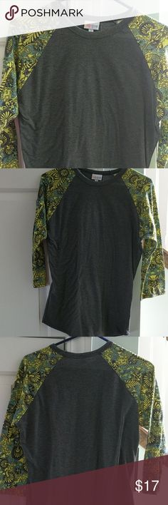 LulaRoe Randy size small This is in excellent condition as it has never been worn. The body is dark gray (charcoal) and the sleeves are lime green and turquoise designs. LuLaRoe Tops Tees - Long Sleeve