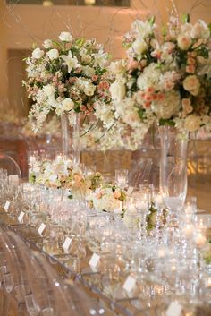 Glamorous pink and white floral wedding reception centerpiece with glass decor; Featured Photographer: McClanahan Studio