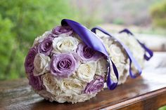 Choose classy rose balls as your bouquet, with a delicate ribbon to loop of your wrist.