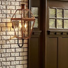 The Quoizel Rue De Royal Outdoor Wall Sconce preserves the timeless look of gas lighting without the hassle of a propane feed. Made of solid copper, the sturdy frame supports clear glass shades. It is also complemented with hand riveting for a little bit of a personal touch. Classics never go out of style, and neither will your outdoor living space with the romantic reproduction of the antique gas light.