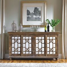 An amazing and beautiful buffet, the Strand 4 Door is crafted from sustainable, plantation grown mango wood. The solid wood construction is accented with mirror glass and iron hardware. The Strand wil