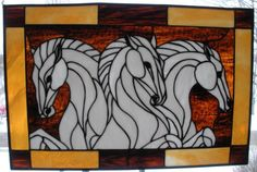 """The classic """"Three Stallions"""" picture depicted through stained glass! This piece is about 25"""" long and 17"""" high. $239.00"""