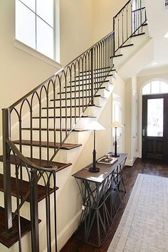 33 Topside Row The Woodlands, TX 77380: Photo   Extensive wood flooring with wrought iron ballesters