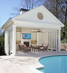 Buckhead pool and cabana with fireplace, Bahamian shutters and limestone deck. Buckhead pool and cabana with fireplace, Bahamian shutters and limestone deck. House Design, Pool House, Outdoor Rooms, Shutter Wall, Pool Houses, Pool House Designs, Outdoor Design, Pool Cabana, Pool House Plans