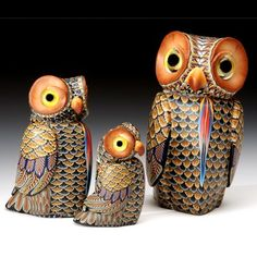 Owls (Mama, Papa, & Baby) by Fimo Creations and artist Jon Anderson. So beautiful and unique. The sculptures are made with tiny polymer clay tiles hand-laid in a mosaic-like pattern of color and shape. Each piece is one of a kind!!