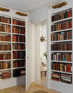 Custom home library with floor to ceiling shelves